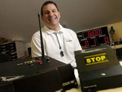 Mike Costabile, of Bolivia, has developed a system to stop the clock as quickly as possible in basketball games, Click to enlarge